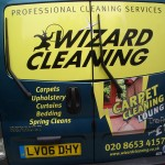 Back of A Blue Wizard Cleaning Van